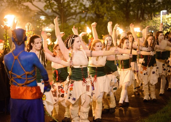 Photo of Whites and a Blue lit by torches at Beltane 2014 by Jasper Schwartz