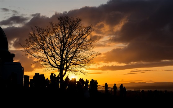 Crowds gathering at sunset on Beltane night 2015, by Neil Barton
