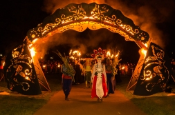 The procession passes through the fire arch, into the underworld, where she begins to gather up energy for the push toward Summer | Photo by Mark S I Taylor for Beltane Fire Society. All rights reserved.
