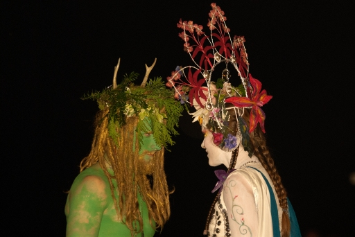 The crucial aspect of the Green Man's role is his death and subsequent rebirth, which provides the centrepiece of our ritual. The May Queen, having gathered the many elemental forces around the hill, spins them into a vortex, creating the right conditions for the Green Man's return. Witnessed by both our own community and the wider community of witnesses, this powerful death and rebirth sequence binds us together in our hope and desire for renewal. The Green Man then presents himself to his Queen – if he is worthy, she will accept him as her new consort. | Photo by Milan Chudjak for Beltane Fire Society.
