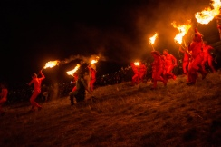 The Reds charge the procession | Photo by Pascal van der Meiden for Beltane Fire Society. All rights Reserved.
