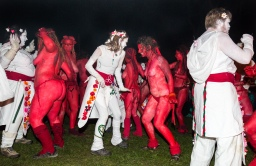 The May Queen and Green Man lead the procession away to the Bower, and eventually the Reds and Whites dance and the whole community celebrates the coming of Summer | Photo by Neil Barton for Beltane Fire Society. All Rights Reserved.